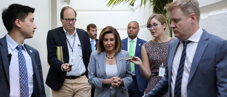 U.S. House Speaker Pelosi arrives for a House Democratic caucus meeting at the U.S. Capitol in Washington