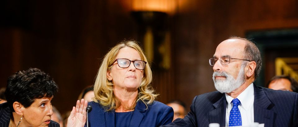 Christine Blasey Ford, with lawyers Debra Katz and Michael R. Bromwich, answers questions at a Senate Judiciary Committee hearing on September 27, 2018. (Melina Mara/Pool/Getty Images)