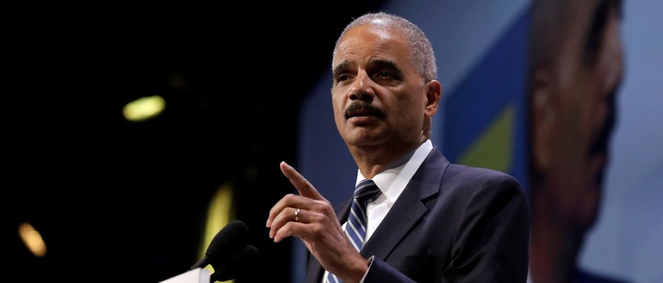 Former U.S. Attorney General Eric Holder addresses the Human Rights Campaign (HRC) dinner in Washington, U.S., Sept. 15, 2018. REUTERS/Yuri Gripas