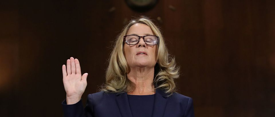Christine Blasey Ford is sworn in before testifying the Senate Judiciary Committee in the Dirksen Senate Office Building on Capitol Hill Sept. 27, 2018 in Washington, D.C. (Photo by Win McNamee/Getty Images)