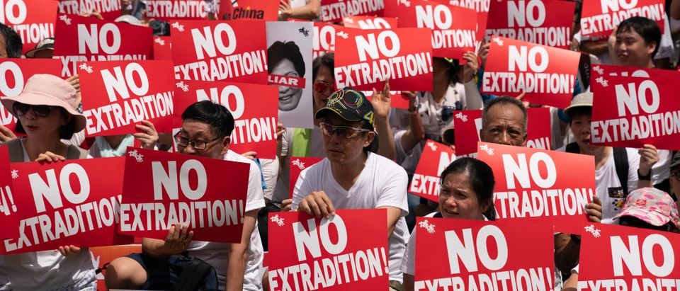 Protesters hold placards and shout slogans during a rally against the extradition law proposal on June 9, 2019 in Hong Kong China. Hundreds of thousands of protesters marched in Hong Kong in Sunday against a controversial extradition bill that would allow suspected criminals to be sent to mainland China for trial. (Photo by Anthony Kwan/Getty Images)