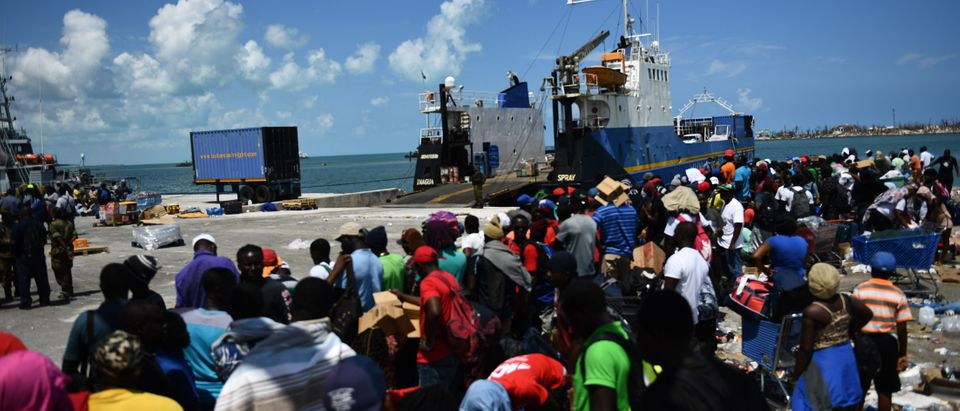 People wait to board a cargo ship for evacuation to Nassau at the port after Hurricane Dorian September 7, 2019, in Marsh Harbor, Great Abaco. (BRENDAN SMIALOWSKI/AFP/Getty Images)