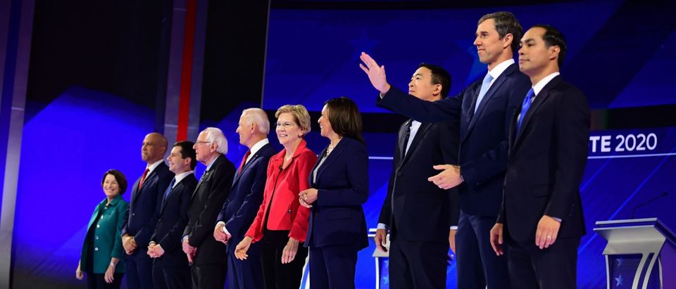 Democratic presidential hopefuls (L-R) Senator of New Jersey Cory Booker, Mayor of South Bend, Indiana, Pete Buttigieg, Senator of Vermont Bernie Sanders, Former Vice President Joe Biden, Senator of Massachusetts Elizabeth Warren, Senator of California Kamala Harris, Tech entrepreneur Andrew Yang, Former Representative of Texas Beto O'Rourke and Former housing secretary Julian Castro stand onstage ahead of the third Democratic primary debate of the 2020 presidential campaign season hosted by ABC News in partnership with Univision at Texas Southern University in Houston, Texas on Sept. 12, 2019. (Photo: FREDERIC J. BROWN/AFP/Getty Images)