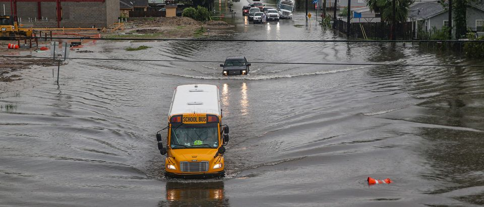 A school bus makes its way on the flooded Hopper Rd. on September 19, 2019 in Houston, Texas. (Thomas B. Shea/Getty Images)