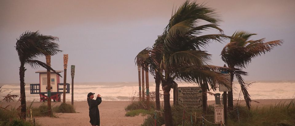 A woman takes a picture as the effects of Hurricane Dorian begin to be felt on September 2, 2019 in Cocoa Beach, Florida. (Scott Olson/Getty Images)