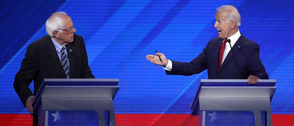 HOUSTON, TEXAS - SEPTEMBER 12: Democratic presidential candidates Sen. Bernie Sanders (I-VT) and former Vice President Joe Biden interact during the Democratic Presidential Debate at Texas Southern University's Health and PE Center on September 12, 2019 in Houston, Texas. Ten Democratic presidential hopefuls were chosen from the larger field of candidates to participate in the debate hosted by ABC News in partnership with Univision. (Photo by Win McNamee/Getty Images)