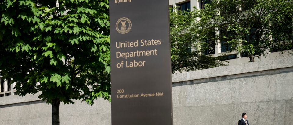 A man walks from the U.S. Department of Labor building on May 3, 2013 in Washington, D.C. (BRENDAN SMIALOWSKI/AFP/Getty Images)