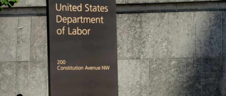 A man walks by the US Department of Labor building on May 3, 2013 in Washington, DC. (BRENDAN SMIALOWSKI/AFP/Getty Images)