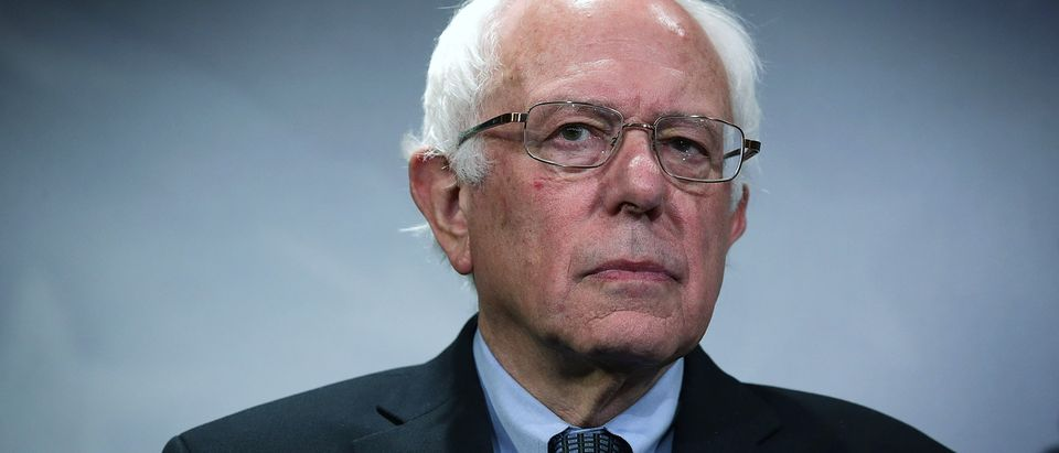 Sen. Bernie Sanders (I-VT) listens during a news conference about private prisons September 17, 2015 on Capitol Hill in Washington, DC. Sanders was joined by Rep. Keith Ellison (D-MN) to announce that they will introduce bills to ban private prisons. (Photo by Alex Wong/Getty Images)