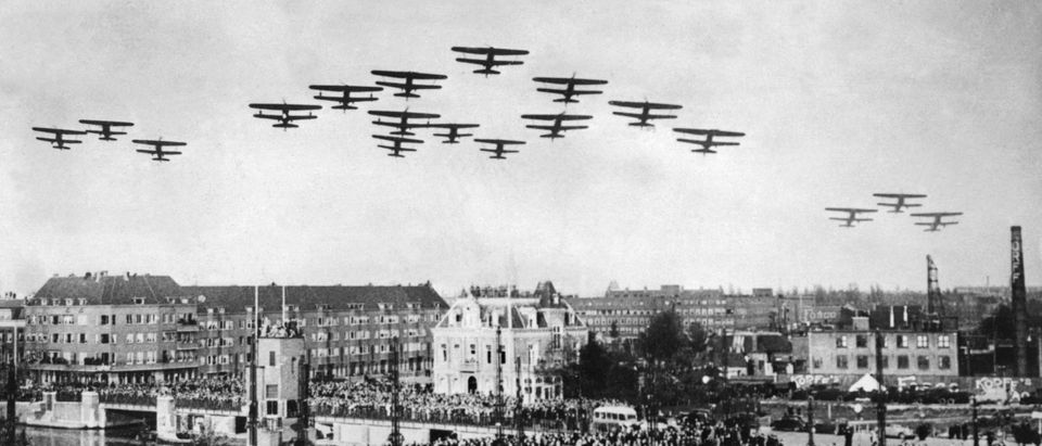 AMSTERDAM, NETHERLANDS: Photo taken during the World War II of planes flying above a Dutch city. (Photo credit should read AFP/Getty Images)