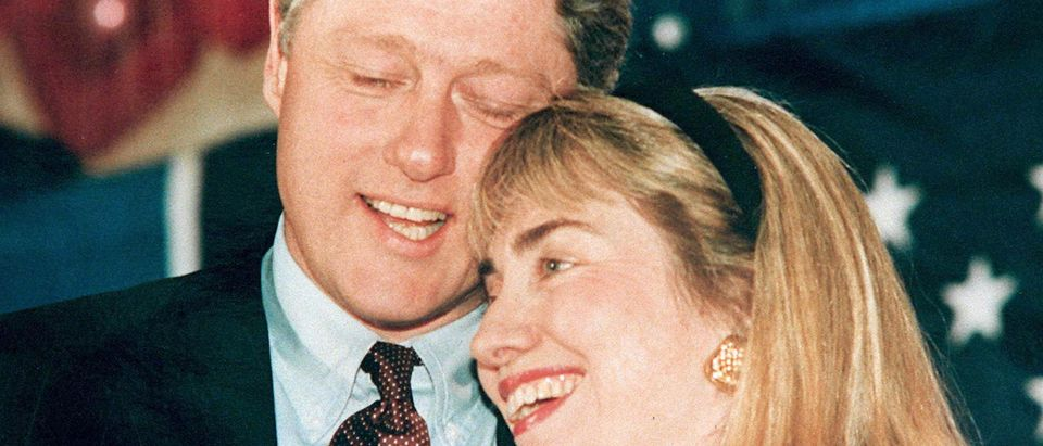 WASHINGTON, : A 1992 photo shows then Governor of Arkansas Bill Clinton (L) and his wife Hillary (R) embracing. Clinton has been accused of having an affair with a former White House intern, Monica Lewinsky, and during a depostion 17 January in the Paula Jones sexual harrassment suit, he admitted to having a relationship with Gennifer Flowers when he was governor. (Photo credit should read AFP/AFP/Getty Images)