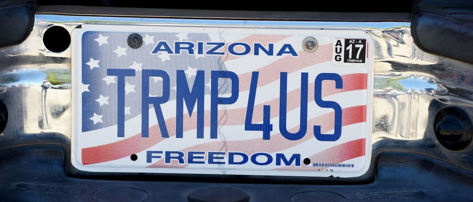 "A car license plate reads ""TRMP4US"" outside a rally by Republican presidential candidate Donald Trump at the Prescott Valley Event Center, October 4, 2016 in Prescott Valley, Arizona. (ROBYN BECK/AFP/Getty Images)"
