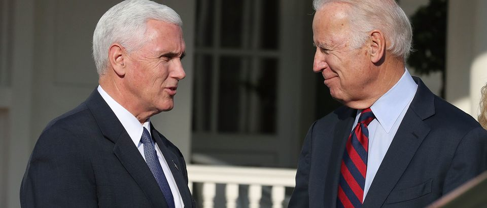 WASHINGTON, DC - NOVEMBER 16: Vice President Joseph Biden, (R), shakes hands with Vice President-elect Mike Pence, at the Naval Observatory, on November 16, 2016 in Washington, DC. Vice President Biden and his Wife, Dr. Jill Biden, hosted a luncheon for Vice President-elect Pence and his wife Karen. (Photo by Mark Wilson/Getty Images)