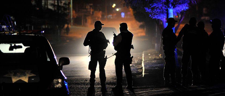 Polive patrol a crime scene ... FERNANDO BRITO/AFP/Getty Images