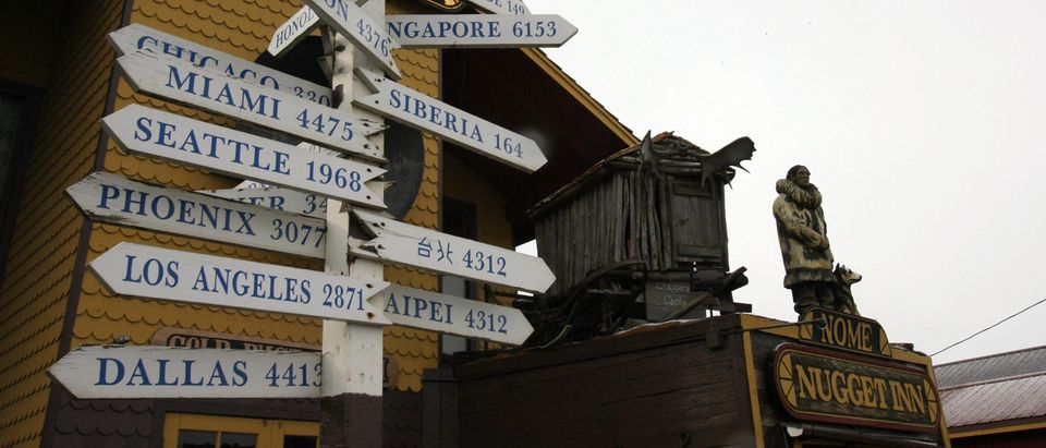 Signs in front of the Nugget Inn directs visitors in Nome, Alaska, to other parts of the world 29 September 2006. (Photo: GABRIEL BOUYS/AFP/Getty Images)