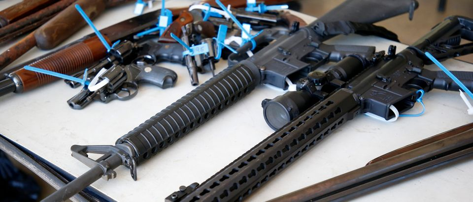 Two AR-15 rifles, along with other assorted guns, sit on a table after being surrendered during a City of Miami gun buy-back event in Miami, Florida on March 17, 2018. (RHONA WISE/AFP/Getty Images)