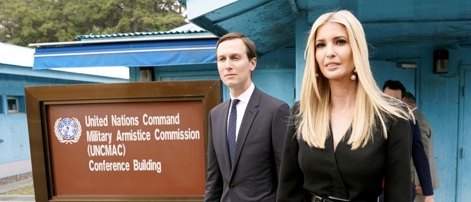 White House senior advisors Ivanka Trump and Jared Kushner walk at the demilitarized zone separating the two Koreas