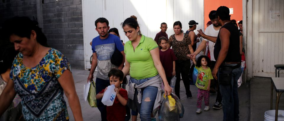 """Central American migrants, returned from the U.S. to Nuevo Laredo in Mexico under the Migrant Protection Protocol to wait for their court hearing for asylum seekers, are seen arriving to the """"Casa INDI"""" migrant shelter in Monterrey"""