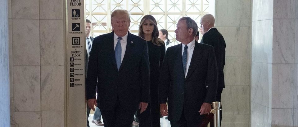 President Donald Trump and First Lady Melania Trump arrive with Chief Justice John Roberts to pay respects to the late Justice John Paul Stevens on July 22, 2019. (Nicholas Kamm/AFP/Getty Images)
