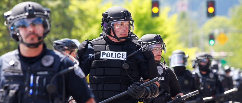 Police block a road during a rally by the Patriot Prayer group in Portland