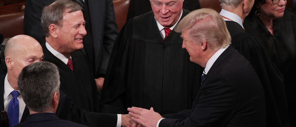President Donald Trump shakes hands with Chief Justice John Roberts during a joint session of Congress on February 28, 2017. (Alex Wong/Getty Images)