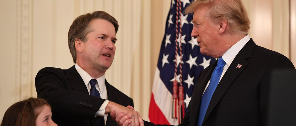 Justice Brett Kavanaugh shakes hands with President Donald Trump after his nomination to the Supreme Court on July 9, 2018. (Saul Loeb/AFP/Getty Images)
