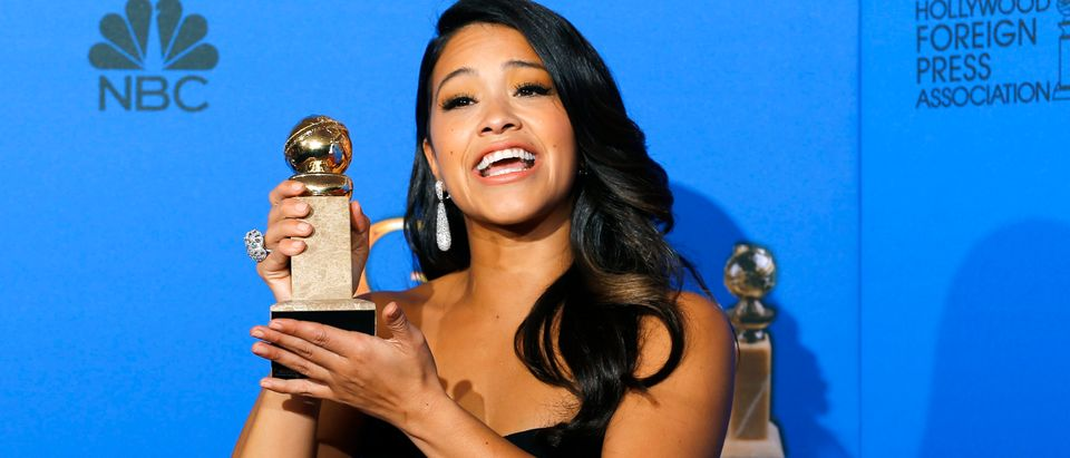 "Gina Rodriguez poses with her award for Best Actress in a TV Series, Musical or Comedy for her role in ""Jane the Virgin"" backstage at the 72nd Golden Globe Awards in Beverly Hills, California Jan. 11, 2015. REUTERS/Mike Blake"