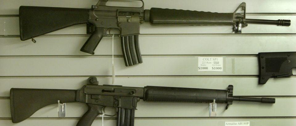 Assault style rifles hang on display in a Dallas Texas gun shop.