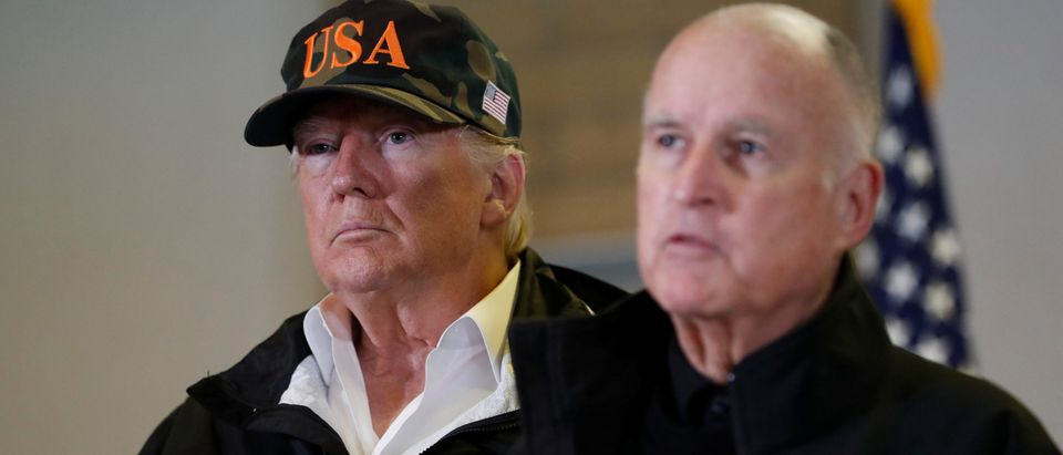U.S. President Donald Trump looks on as California Governor Jerry Brown speaks during a briefing with State officials after visiting the charred wreckage of Skyway Villa Mobile Home and RV Park in Paradise, in Chico, California, U.S., November 17, 2018. REUTERS/Leah Millis