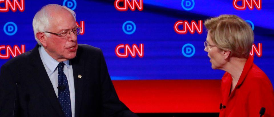 U.S. Senators Warren and Sanders chat on the first night of the second 2020 Democratic U.S. presidential debate in Detroit, Michigan, U.S.