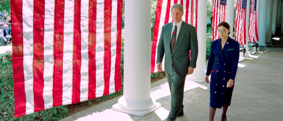 President Bill Clinton walks with Justice Ruth Bader Ginsburg at the White House on June 14, 1993. (David Ake/AFP/Getty Images)