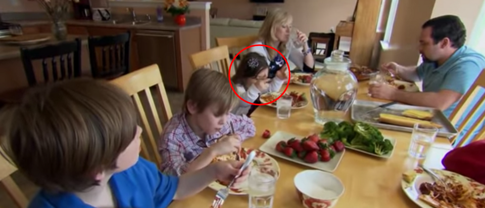 Grace seems to appear seated next to her adoptive mother in this scene from a 60 Minutes profile about the family's other child, Jake. (YouTube/60 Minutes)