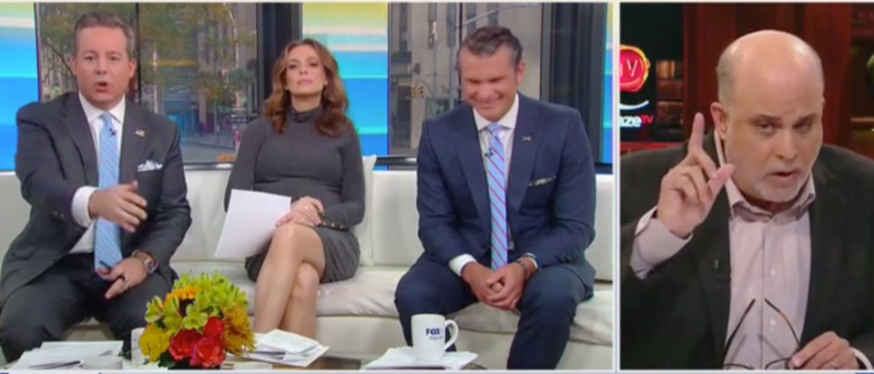 """Mark Levin and Ed Henry spar on """"Fox and Friends"""" Sunday. Screen Shot/Fox News"""
