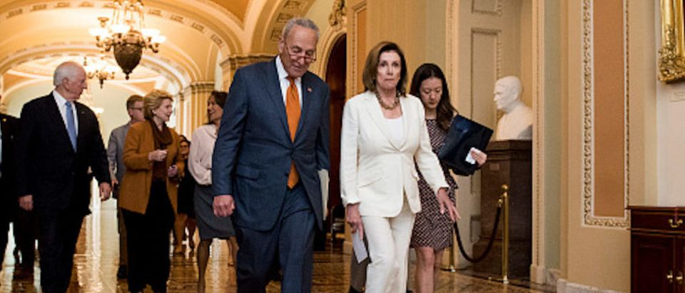 Senate Minority Leader Chuck Schumer, D-N.Y., and Speaker of the House Nancy Pelosi, D-Calif., walk to their joint press conference in the Capitol to discuss the Senate voting on the Bipartisan Background Checks Act on Monday, Sept. 9, 2019