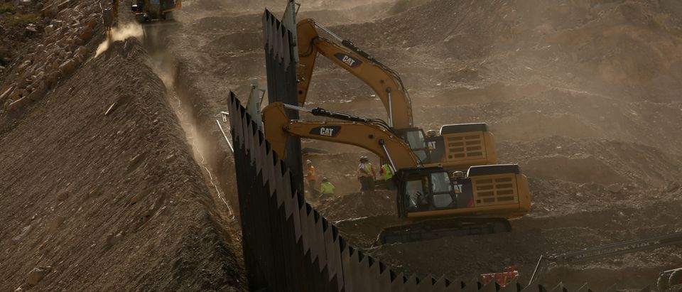 A general view shows heavy machinery working on a bollard-type private border wall, crowd-funded by We Build The Wall group at Sunland Park, New Mexico, as pictured from Ciudad Juarez