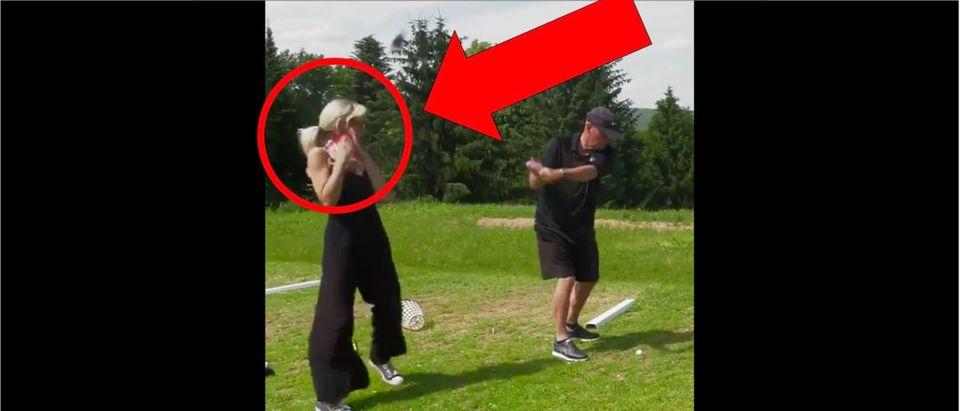 Woman hit by golf club (Credit: Screenshot/Twitter Video https://twitter.com/barstoolsports/status/1168629213378863104?s=21)