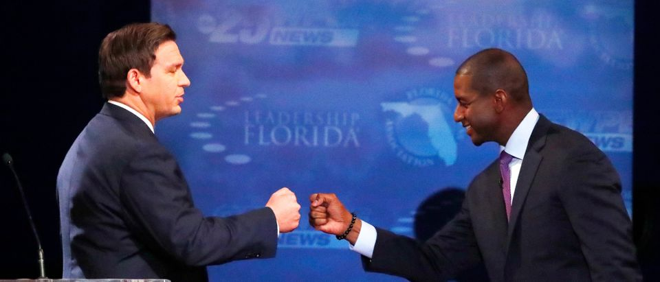Florida gubernatorial candidates, Republican Ron DeSantis, (L), and Democrat Andrew Gillum fist bump after a debate, at Broward College in Davie, Florida, U.S. October 24, 2018. Wilfredo Lee/ Pool via REUTERS