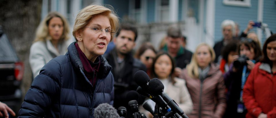 U.S. Senator Elizabeth Warren (D-MA) speaks to reporters, after announcing she has formed an exploratory committee to run for president in 2020. REUTERS/Brian Snyder
