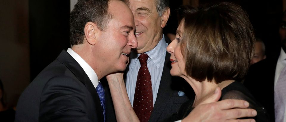 House Speaker Nancy Pelosi (D-CA) and Congressman Adam Schiff (D-CA) hug as they arrive ahead of comedian Dave Chappelle receiving the Mark Twain Prize for American Humor at the Kennedy Center in Washington