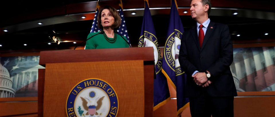 U.S. House Speaker Pelosi speaks next to House Intelligence Committee Chairman Schiff regarding the impeachment inquiry of U.S. President Trump in Washington