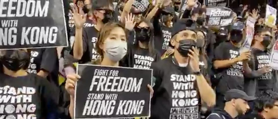 Pro-democracy protesters supporting Hong Kong are seen on the stands of Barclays Center during a game between the Brooklyn Nets and Toronto Raptors, in New York City