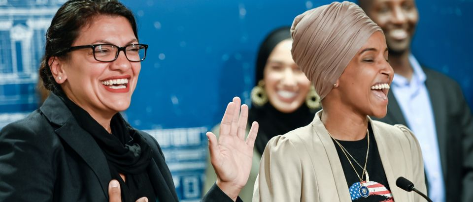 U.S. Representatives Rashida Tlaib and Ilhan Omar react as they discuss travel restrictions to Palestine and Israel during a news conference in St Paul