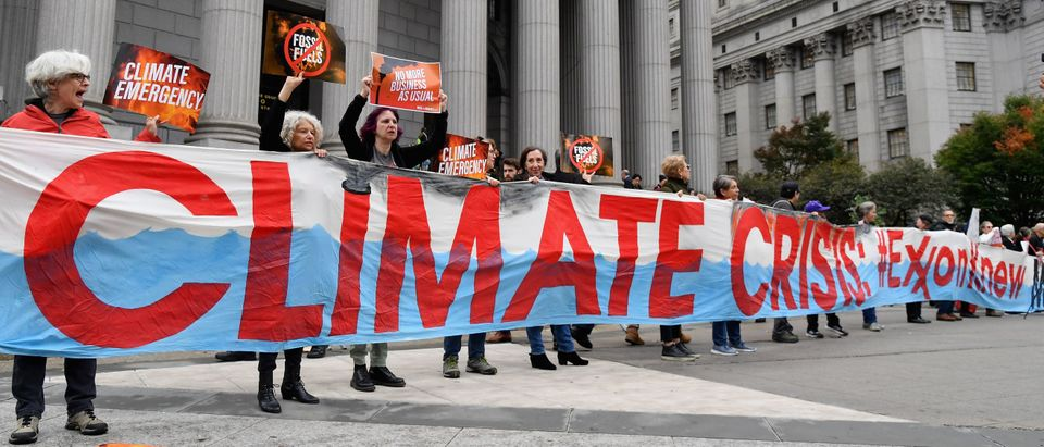 Climate activists protest outside the New York State Supreme Court building on Oct. 22, 2019. (Angela Weiss/AFP/Getty Images)