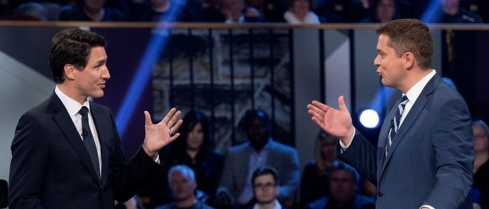 Conservative leader Andrew Scheer and Liberal leader Justin Trudeau gesture to each other during the Federal leaders debate in Gatineau