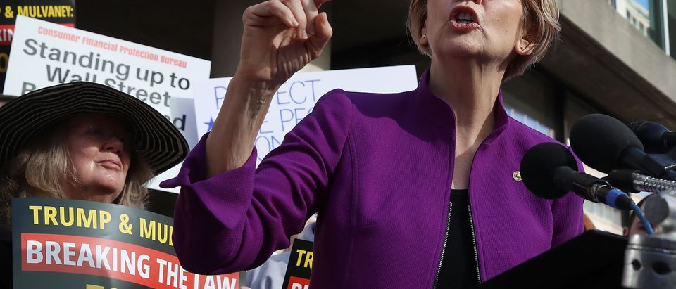 Sen. Elizabeth Warren (D-MA) speaks during a protest in front of the Consumer Financial Protection Bureau (CFPB) on November 28, 2017. (Mark Wilson/Getty Images)