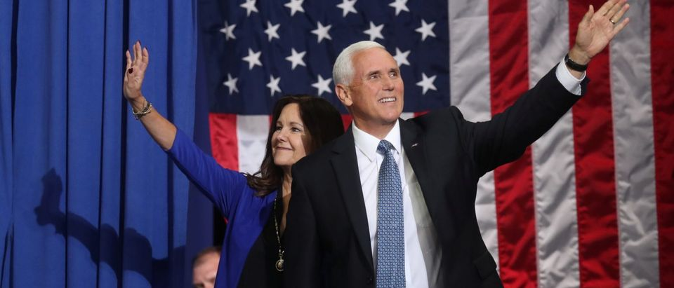 U.S. Vice President Mike Pence and his wife Karen Pence wave during a campaign rally in Minneapolis
