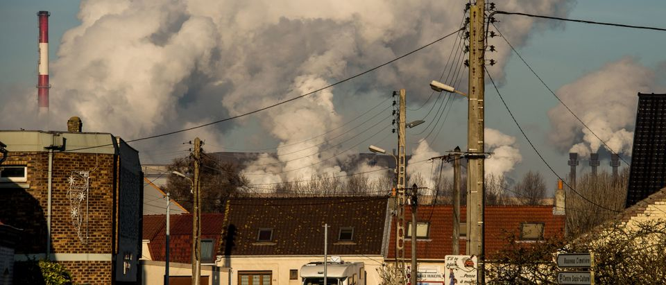 Smoke rises from chimneys of a factory in Dunkirk, France on December 5, 2016. (Philippe Huguen/AFP/Getty Images)