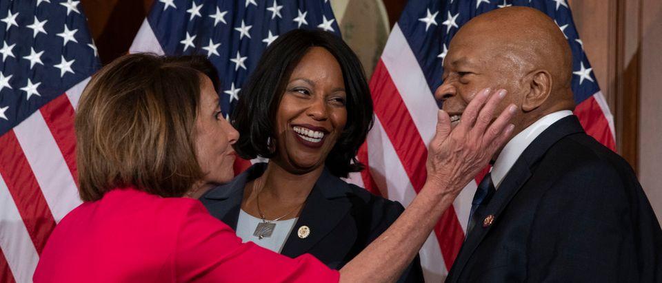 Speaker of the House Nancy Pelosi (L), D-CA, congratulates incoming Chair of the House Oversight Committee Elijah Cummings (D-MD) and wife Maya Rockeymoore during a ceremonial swearing-in at the start of the 116th Congress at the US Capitol in Washington, DC, January 3, 2019. (ALEX EDELMAN/AFP/Getty Images)