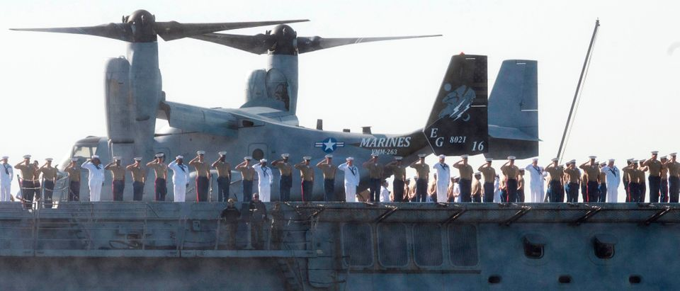 Sailors and Marines salute from the USS New York as the US Navy vessel takes part in Fleet Week 2019, on May 22, 2019, in New York. (JOHANNES EISELE/AFP/Getty Images)