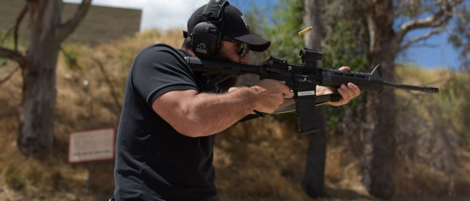 "Rabbi Raziel Cohen, aka ""Tactical Rabbi"", shoots an AR-15 style semi-automatic rifle during a demonstration at the Angeles Shooting Ranges in Pacoima, California on May 20, 2019. (Photo by Agustin PAULLIER / AFP/Getty Images)"